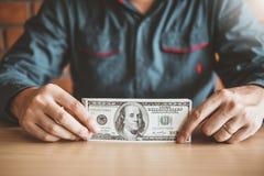 Man calculator Accounting Calculating with US Dollar money growing saving money