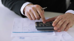 Man with calculator filling a form. Business, tax, office, school and education concept - man with calculator filling a form stock video