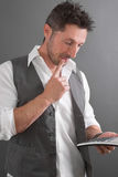 Man with calculator Royalty Free Stock Image