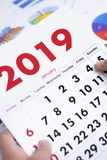 Man with a calendar of 2019 royalty free stock photo