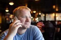Man calling from cafe Stock Photos