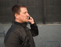 Man calling with a cell phone. Royalty Free Stock Photography