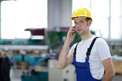 Man calling in factory Stock Image