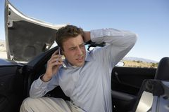 Man Calling For Help. Young tensed man calling for help Royalty Free Stock Photos