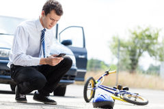 Man calling for help after accident Royalty Free Stock Photos