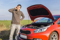 Man is calling help for broken car. Insurance and assistance concept Royalty Free Stock Photography