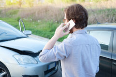 Man calling help after car crash accident on the road royalty free stock photo