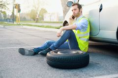 Man calling help service for a flat tyre royalty free stock photos