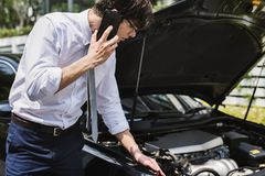Man calling for help to fix his car Stock Image