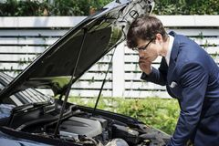Man calling for help to fix his car Royalty Free Stock Images