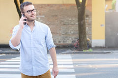 Man calling on his smartphone Royalty Free Stock Photo