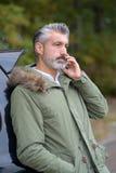 Man calling insurance after car breakdown. Man calling insurance after a car breakdown Stock Images