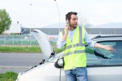 Man calling mechanic after car breakdown Royalty Free Stock Photos