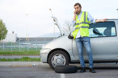 Man calling mechanic after car breakdown. Man calling mechanic help service after car engine breakdown Royalty Free Stock Photo