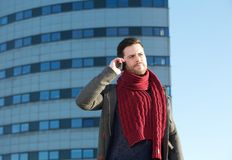 Man calling by mobile phone outside office building Royalty Free Stock Photos
