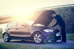 Man calling by phone to get help. With his damaged car Royalty Free Stock Photo