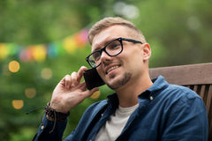 Man calling on smartphone at summer garden party Stock Photography