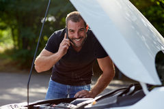 Man calling someone for help Stock Images