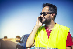Man calling to insurance company after a car breakdown. Royalty Free Stock Photo