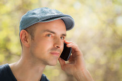 Man calling using smartphone outdoor Stock Photography