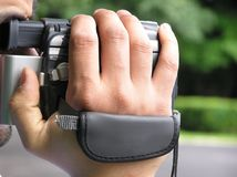 Man with camcorder. Man recording images using a camcorder Royalty Free Stock Photography