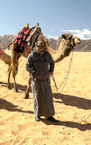 Man with a camel Royalty Free Stock Photo