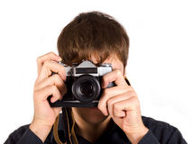 Man with a camera. Man looking at you through the camera Stock Photo
