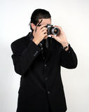 Man with camera. A man with a digital camera royalty free stock image
