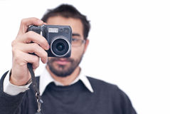 Man with camera. Smileing man holding camera in his hands isolated on white Stock Images