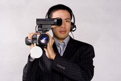 Man with camera. Man holding a professional camera royalty free stock photography