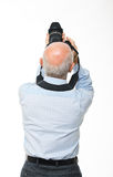 Man with camera back view Stock Photography