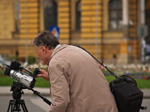 Man With Camera And Bag. Adult man with camera and bag on his shoulder Royalty Free Stock Photography