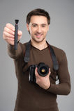 Man with camera and brush. Royalty Free Stock Image