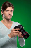Man with camera. Royalty Free Stock Image