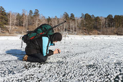 The man with the camera in a hand removes a snow background on t Stock Photo