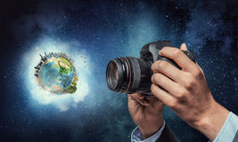 Man with camera in hands Stock Photos