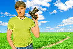 A man with a camera in nature. Stock Photography