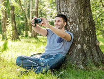 Man with camera Stock Photos