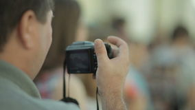 A man with a camera removes the competition. A man with a camera shoots the summer competitions on snowboard stock footage