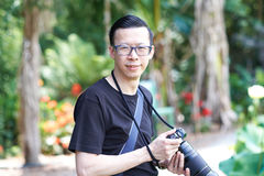 Man with camera. Man with telephoto lens on camera royalty free stock image