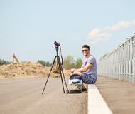 Man with camera on tripod. Man with photo camera on tripod taking timelapse photos in the city Stock Photography