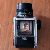 Man in camera viewfinder Stock Photo