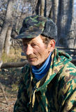 Man in Camouflage 13. A portrait of a man in camouflage at forest. Autumn, sunny day Royalty Free Stock Photo