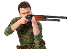 Man in camouflage aims from gun Royalty Free Stock Image