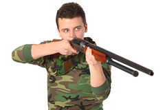 Man in camouflage aims from gun Stock Images