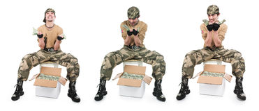 man in camouflage with box of money Royalty Free Stock Image