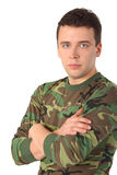 Man in camouflage with crossed hands Stock Photos