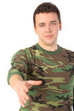 Man in camouflage greets royalty free stock photo
