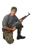 Man in camouflage with gun. Royalty Free Stock Photos