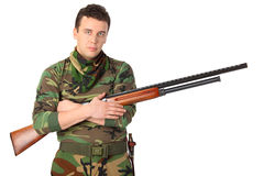 Man in camouflage with gun Stock Photos